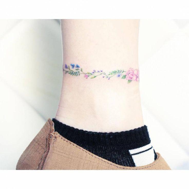 Flower bracelet tattoo on the ankle.