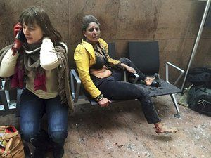 Nidhi Chaphekar, a 40-year-old Jet Airways flight attendant from Mumbai, right, and another unidentified woman are shown after being wounded in Brussels Airport