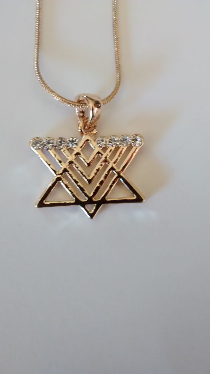Star of David with Menorah necklace. It is gold color. 18 inch chain. (Note: it is costume jewelry - not real silver/gold. Hey, what do you expect for $11. LOL) PLEASE ESTIMATE THE SIZE OF IT BY THE D                                                                                                                                                                                 More