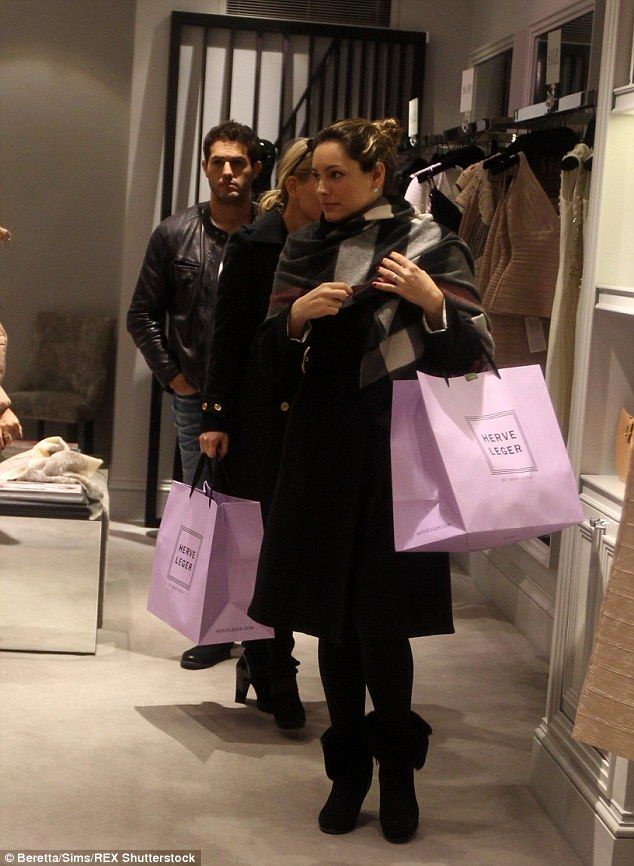 Shopped out: Jeremy looked slightly bored as he followed his stunning girlfriend around se...