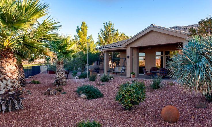 Southwestern Landscape/Yard with exterior stone floors, Bird bath, Fence