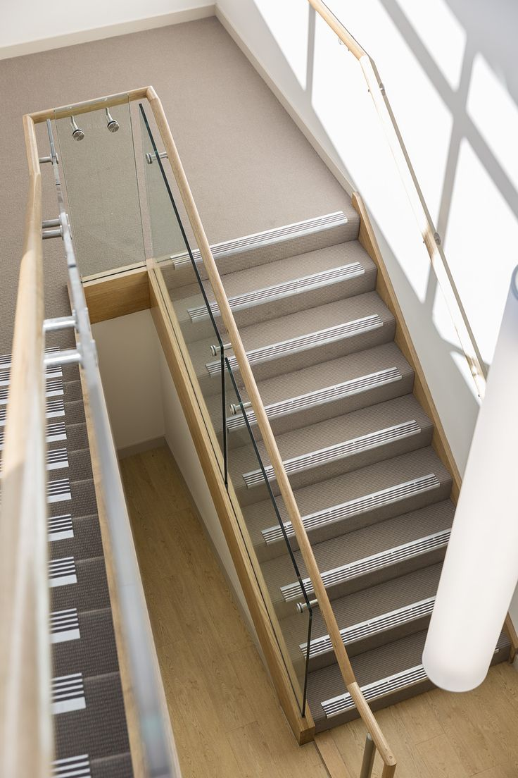 Stair | Staircase | Commercial | Non Slip Treads | Tasmanian Oak | Closed Stair | Carpet | Timber Handrail | Glass Balustrade | Stainless Steel Brackets