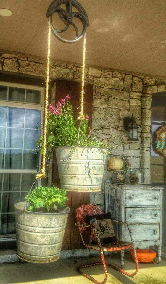 Hang galvanized buckets for some awesome planters.