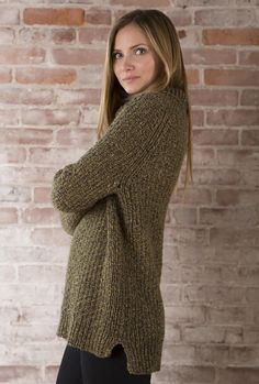 An easy to knit and even easier to wear top down pullover with a turtleneck, rib details and all over texture.