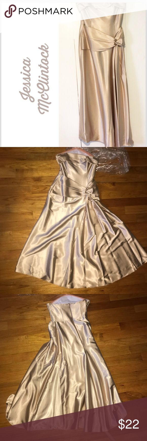 Strapless Gold Jessica McClintock Formal Dress Overall dress is in Great condition their is one small spot on the dress as shown in picture #7 it is on front of dress but not as noticeable because dress is shiny looks more like a shadow.  Size 12 I only wore once for an event Strapless has some wire in top part for bust but no built in bra.  Not lined Purchased at Macy's  Dry cleaned & ready to wear I priced low because of the spot. I did not try to remove but as I said it was dry cleaned…