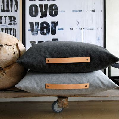 Grey black floor pillows with leather strap handles