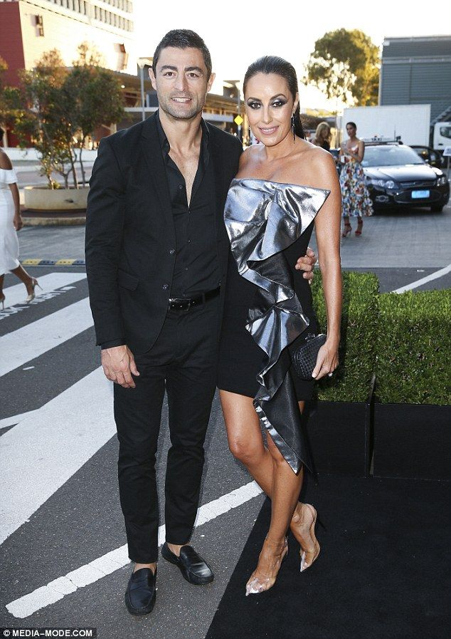 Terry Biviano flaunts her bronzed limbs in a silver dress  They recently threw their beloved daughter Azura a lavish no-expenses-spared fourth birthday party.  But Terry Biviano and her NRL star husbandAnthony Minichiello left their youngster at home on Wednesday as they attended the David Jones Autumn/Winter 18 collections launch in Sydney.  The 41-year-old shoe designer flaunted her bronzed limbs in a thigh-grazing silver trim minidress as she cosied up to her football player partner…
