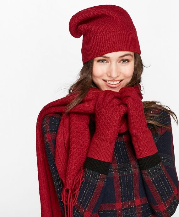 This wonderfully warm, ultra-soft merino wool hat mixes classic rib knit with an intricate lattice stitch for a lush, tactile finish. This cozy hat is crafted to coordinate perfectly with the matching sweater, scarf and gloves.