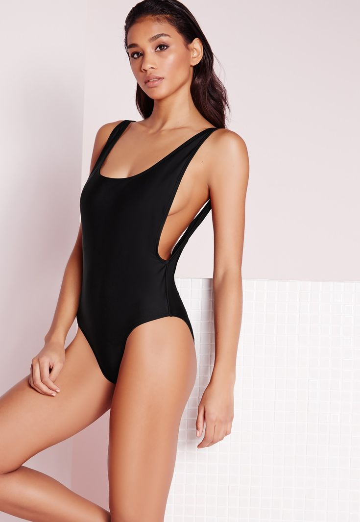 We're totally feelin the 80's vibes with this fierce black swimsuit! With a high leg style and open back finish, this drop side beaut is perfect for hitting the beach. Team up with some fierce shades for a killer finish to your look.
