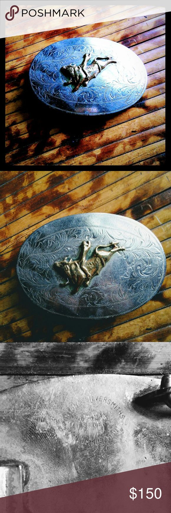 Silver Cowboy Belt Buckle Family hierloom german silver, montana made silver company! Belt buckle gold plaited bull and cowboy on the front! Paisley design in the silver facing! Beautiful antique with the history of the west! My family came from ranching in texas passed down piece! Montana silver Accessories Belts