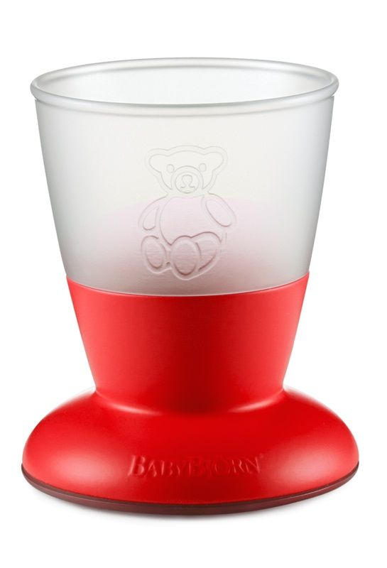 BabyBjorn  Drinking cup in Red The Ergonomic design of the  BabyBjorn   cup  and easy  grip materials makes it an ideal  cup  for  small hands . The  cup  stands firmly and is  difficult to knock over  with thanks to the well conceived design. This durable product is  dishwasher ,  microwave  and  freezer safe . Available in  Bright Funky Colours .
