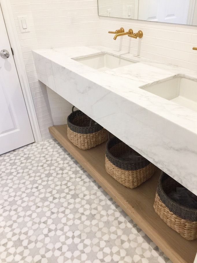 By floating the vanity, the bathroom was kept more spacious and airy and allowed more of the design of the tile to be seen.