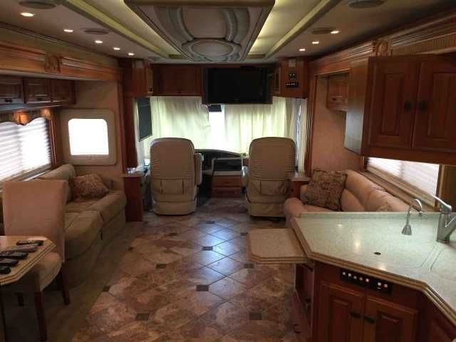 2005 Used Monaco Dynasty 42 DIAMOND IV Class A in Texas TX.Recreational Vehicle, rv, 2005 Dynasty Diamond IV TAG-Axle Diesel Pusher: 8.9L Cummins with 54k and side radiator, Allison 6spd transmission, 4 slides, Aqua-Hot, 3 AC units with heat pumps, auto satellite system, power awnings with remote control, 10KW Onan Quite Diesel Generator on power slide, Auto-Leveling System, integrated power entry steps, full fiberglass roof, dual pane windows with thermal tint, slide out storage tray, 50amp…