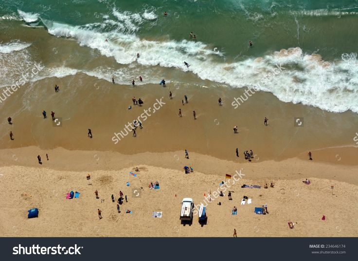 SURFERS PARADISE - NOV 14 2014:Visitors on main beach in Surfers Paradise.It one of Australia's iconic coastal tourist destinations, drawing 10 million tourists every year from all over the world.