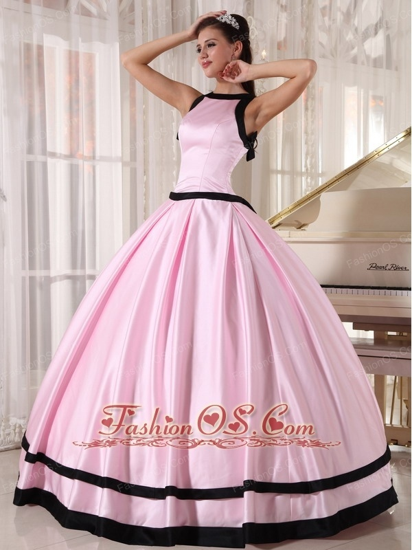 Affordable Baby Pink and Black Quinceanera Dress Bateau Satin Ball Gown http://www.fashionos.com Simple but unique! This ball gown floor length dress is accented with a unique scoop neckline which is decorated by a black trimmed edge. The back design gives a half visiable effect look which adds some sexy to the dress. The bow and the back trimmed edge make the dress appeal to the eyes.