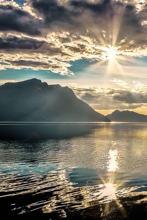 """Fjord in Norway (""""Sunset at the Fjord med baat var"""" photo by Henri Eftevand)"""