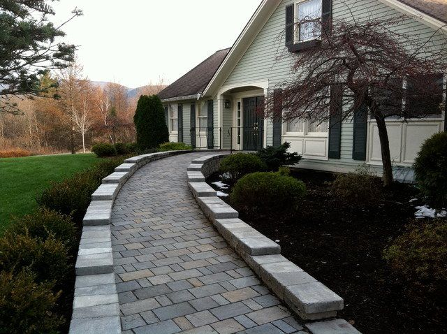 This Natural Bermed Ramp uses the Landscape Architecture. Stone or Interlocking Sections provide a Beautiful Ramp.