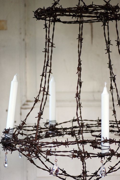 Turn that stash of barbed wire into a chandelier. Add a vintage drop bulb, mabey some candles and a little bling, and you got yourself a winner.......D.