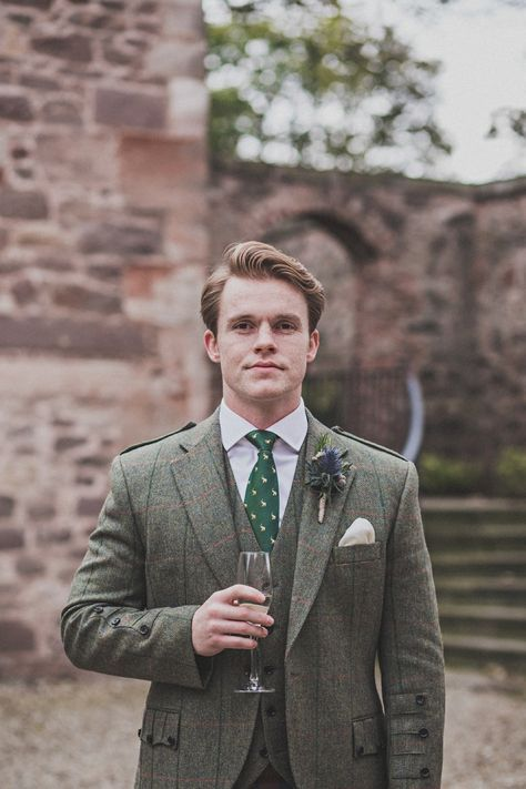 Groom wears a tweed jacket and kilt with a green tie. Photography by http://www.johnelphinstonestirling.com/