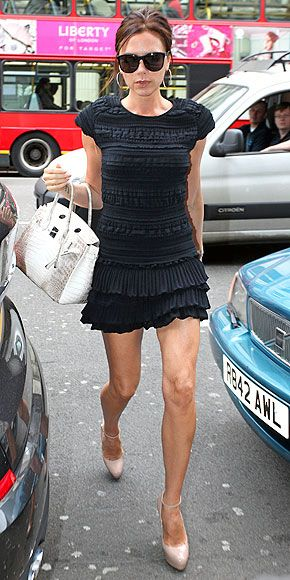 One of my all-time fave Victoria Beckham looks. Isabel Marant ruffled black mini.