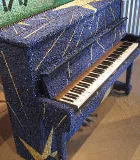 Only in New Orleans will you find a piano covered in Mardi Gras Beads. This was a project, The Louisiana Legends Art Piano, was made by Galeria Alegria to benefit Tipitina's Foundation, a local charity.