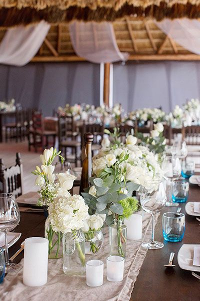 This neutral color palette is anything but boring, thanks to loads of greenery and rustic table runners.
