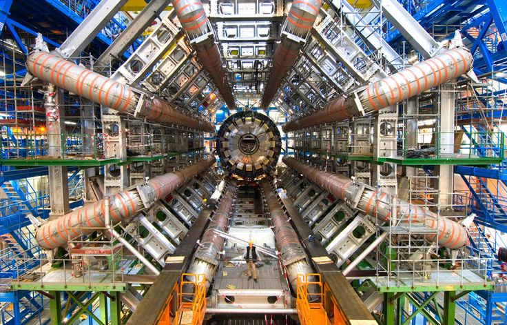 """Images from the construction of """"the massive $4-billion-dollar machine that allowed us peer so closely into the subatomic world."""" (©2012 CERN)"""