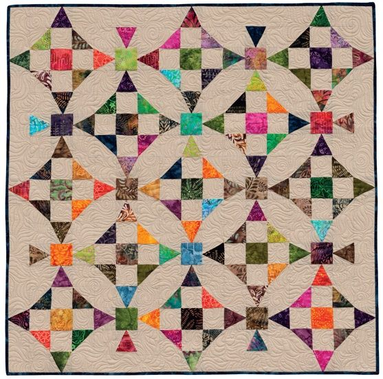 Love the hidden circles in this quilt and it's all straight line sewing.
