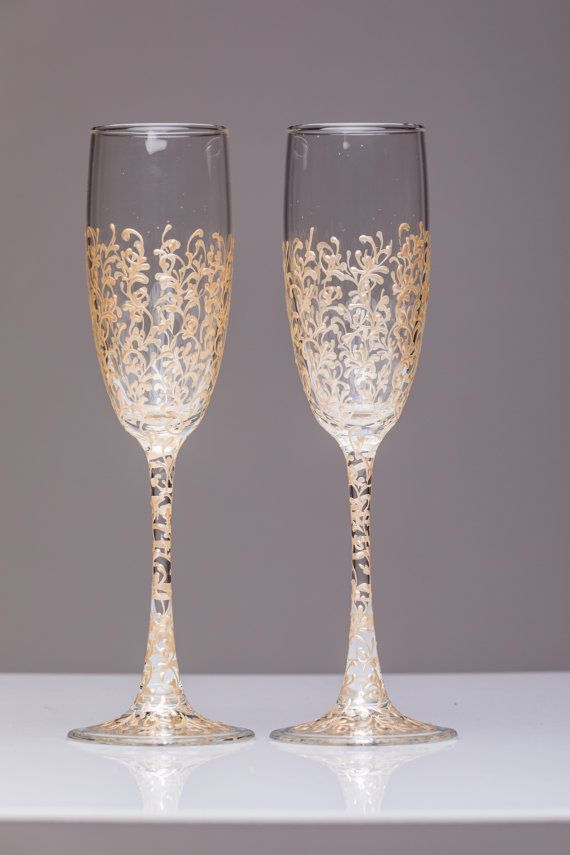 personalized wedding glasses Toasting flutes gold Glasses bride and groom Champagne glasses gold Wedding flutes Toasting flutes set of 2  For these glasses color: champagne paint All completely handmade! MEASUREMENTS: -Champagne flutes : Height - 9.2 inch (23.5 sm). Volume – 170ml (6.1 oz)  Custom champagne glasses may be created to fit your needs. Your unique wedding colors can be used for this design. Names and date may be painted to customize to your occasion. Glasses will be carefully…