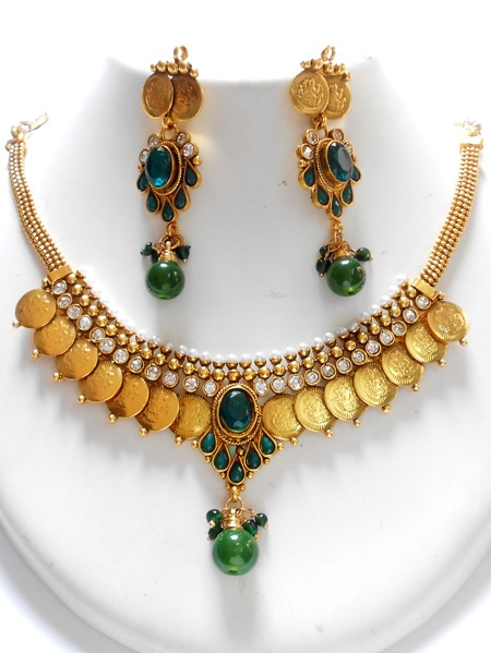Elegane set of high quality copper based, light weight coin polki jewellery, This polki jewellery set avaialable with matching pair of earrings.The Necklace set and the earrings both are designed beautifully with Polki stones and Bead stone work.