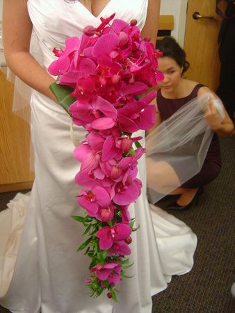 Cascading orchid bouquet - don't think I'd do orchids but I like the casading