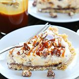 Twix Ice Cream Pie-shortbread cookie crust with a layer of chocolate, vanilla ice cream, chopped Twix candy bars, and salted caramel sauce. Yeah, you need this dessert in your life! Click @twopeasandpod for the recipe link! 💙 https://www.twopeasandtheirpod.com/twix-ice-cream-pie/ #twopeasandtheirpod