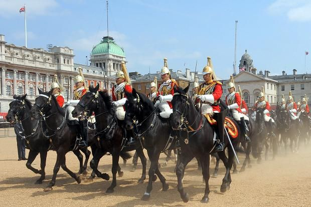 The Queen's procession from Buckingham Palace to Westminster being escorted by the Household Cavalry