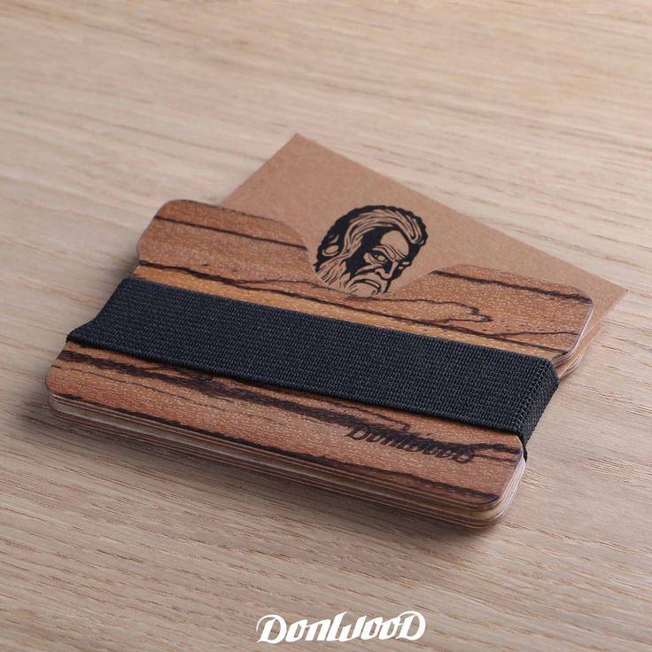 Wooden wallet / cart holder made of Zebra wood.