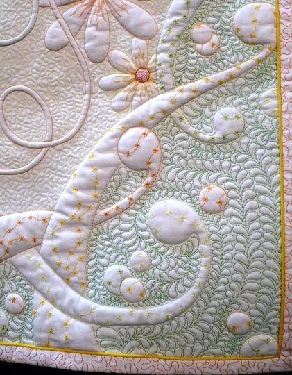 Philippa Naylor--detail of wholecloth quilt, FMQ with trapunto