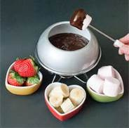 Raspberry-Chocolate Fondue  3/4 C fat-free half and half, pinch salt, 6 oz milk chocolate, chopped, 6 oz semisweet chocolate, chopped, 2 1/2  T raspberry extract, stevia to taste, assorted cut-up fruit, such as strawberries, raspberries, banana and pineapple, for dipping  Bring half and half to a boil in small saucepan over med heat. Remove from heat and add chocolate. Cover and let sit for 3 minutes. Whisk until smooth. Whisk in raspberry extract and sweetener. Serve. Reheat on low as…
