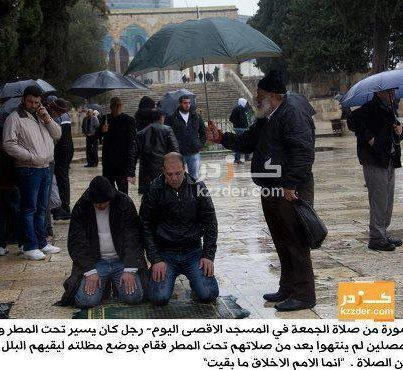 This polite man finished his prayer but before going home , he saw 2 brothers who came late and still praying so he prefered to protect them from rain until they finish their prayer !    Mashaa Allah !    The photo is from almasjid Al-Aqsa (Palestine)    This is Islamic brotherhood ♥