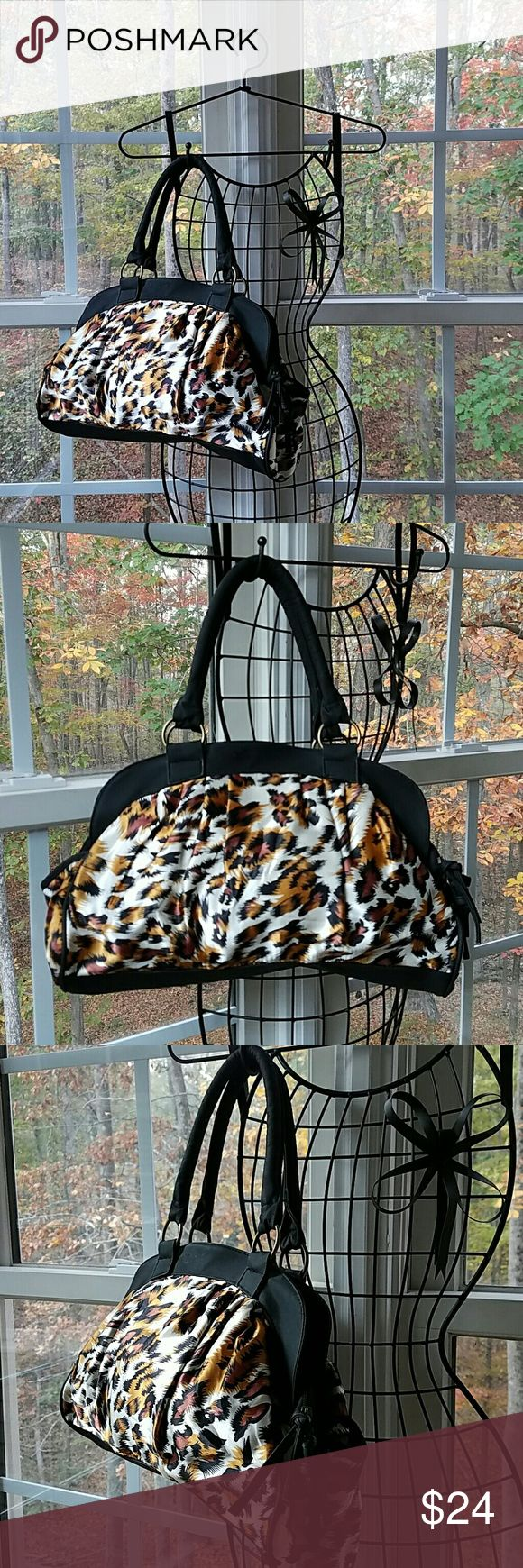 "🆕Fierce Animal Print Boutique Shoulder Bag Check out this fierce animal print shoulder bag! Two side pockets interior zippered pocket and 2 slip pockets. Spacious with bright orange colored interior. Width 16"", Height 8-1/2"", Depth 5"", Strap 8"". Please let me know if you have any questions. Thank you for looking! Xoxoxoxo Victoria Leland Designs Bags Shoulder Bags"