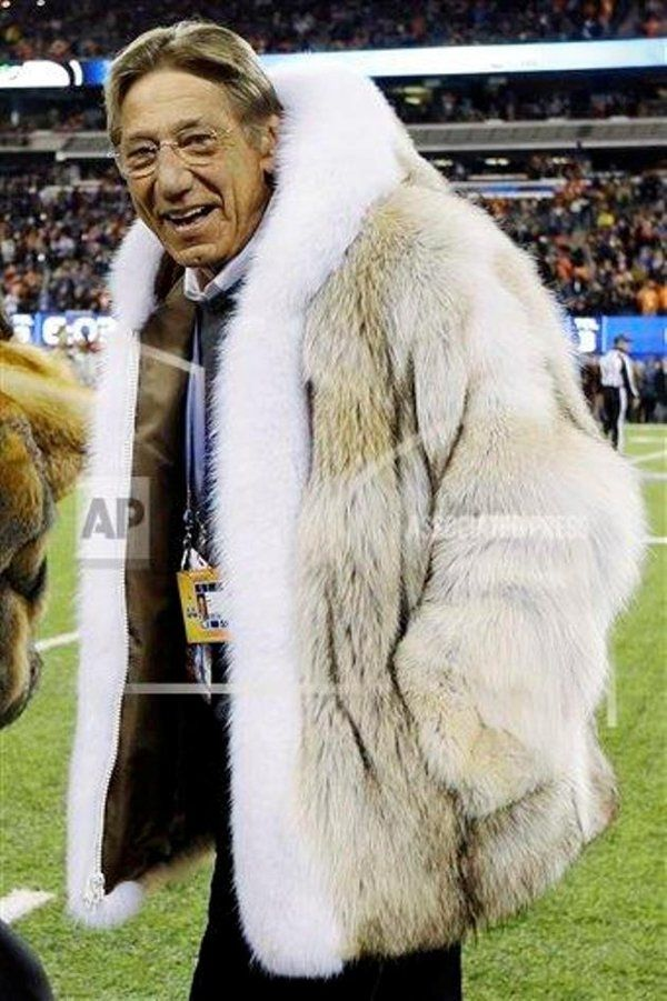 Joe Namath rocks a huge fur coat, shows he's still the coolest guy around, does not care for mild temperatures.