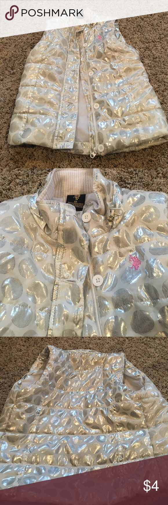 Girls puffer vest U. S. Polo association girls 6x puffer vest. White and metallic silver polka dots. Zipper and button front closure. No pockets. I don't have the hood that was on it. But it was a detachable and looks good without it. EUC u. s. polo association Shirts & Tops