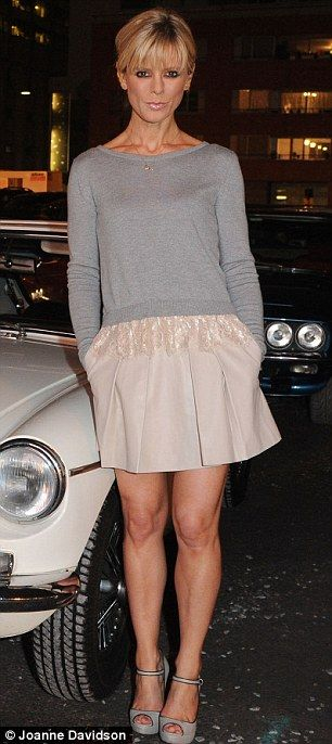 Emilia Fox in a pink skirt dress and grey top.