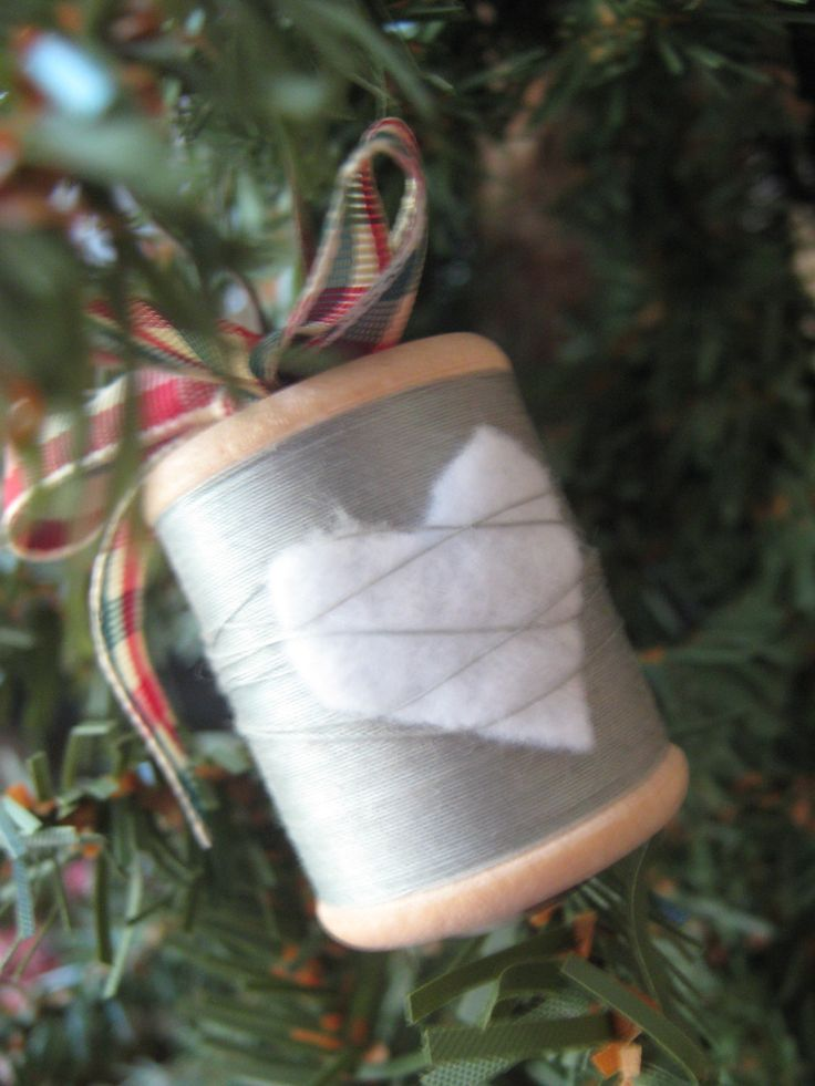Secure a tiny fabric heart to a spool of thread. Add decorative wire and ribbon to make an ornament!
