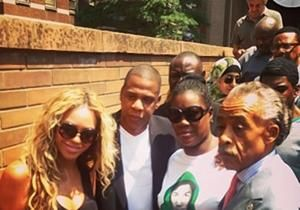 """Platinum-selling power couple Jay-Z and Beyonce appeared Saturday at a """"Justice for Trayvon Martin"""" vigil after the slain teen's mother proclaimed her son's innocence."""