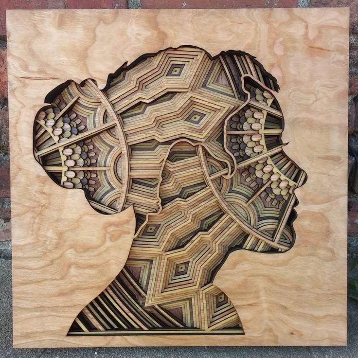 Oakland-based artist Gabriel Schama creates precisely layered wood relief sculptures that are a delight to explore. Each 1/8 inch piece of laser-cut mahogany plywood stacks into an exquisite union of overlapping geometry in mandala-like forms. Recently, Schama has been placing these patterns within human silhouettes for a striking contrast.