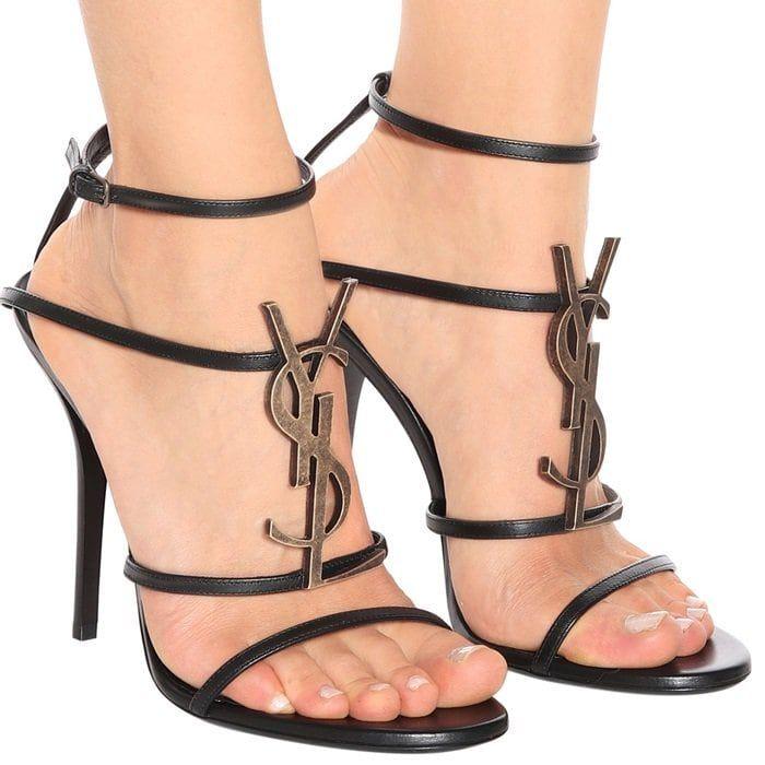 ab74e34a Saint Laurent's Cassandra sandals proudly display the label's YSL ...