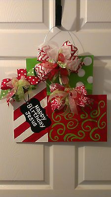 I know this is an ebay listing, but the idea is cute and simple enough I could make one for myself. Handpainted Wood Door Hanger Gift Presents Happy Birthday Jesus | eBay