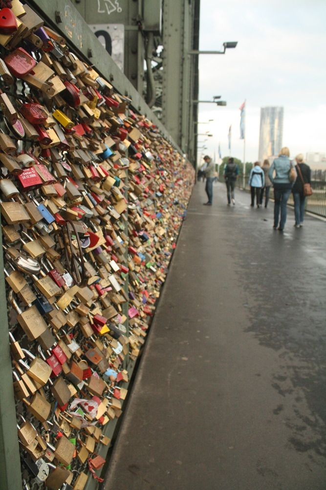 In Germany... Couples will take a lock, and attach it to the bridge's fence and throw the key into Rhine for love and good luck. So, all the way across the whole bridge the fence is covered in locks!  @Daniel Chow
