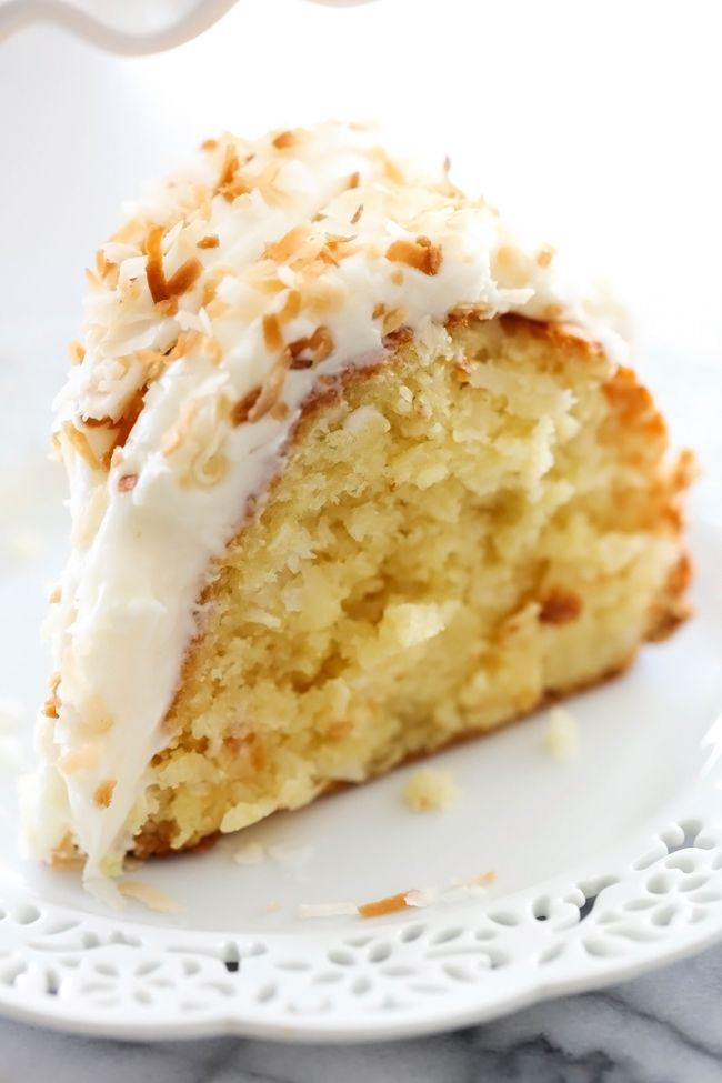 Coconut Bundt Cake... This is an incredibly moist cake loaded with coconut flavor! The Cream Cheese Frosting on top is the perfect pairing. This cake with be loved by all who try it!