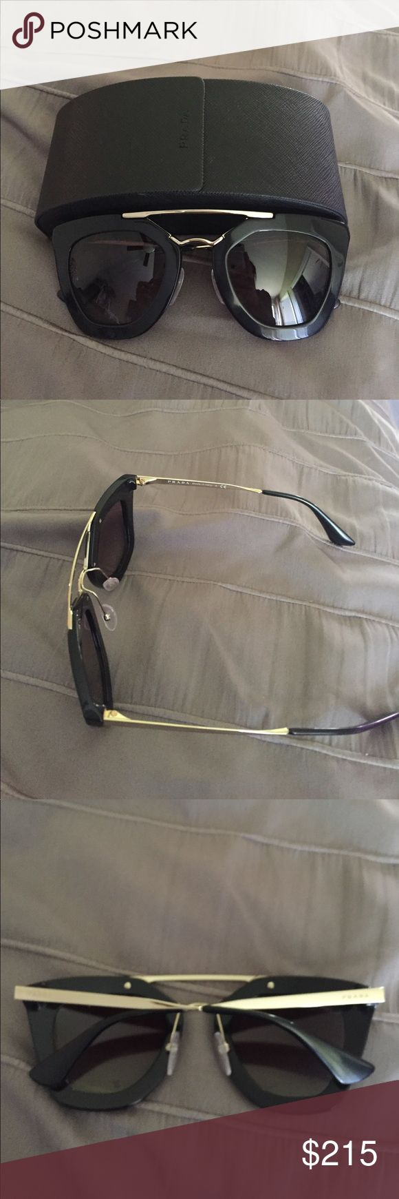 Prada Aviator Sumglasses Like new Prada aviator sunglasses. Only worn once of that. Comes with case and tag also purchased these from Nordstrom store! They are black with gold hardware. No scratches or marks on them. Prada Accessories Sunglasses