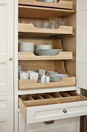 Roll out shelving in cabinet for dishware!